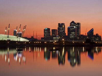 https://imgc.allpostersimages.com/img/posters/london-newham-o2-arena-and-canary-wharf-buildings-reflecting-in-royal-victoria-docks-england_u-L-P8YTX30.jpg?artPerspective=n