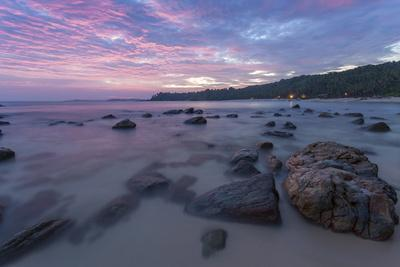 https://imgc.allpostersimages.com/img/posters/long-exposure-of-a-pink-sunset-at-the-beach-during-dusk-with-rocks-in-the-foreground_u-L-PQ8RWB0.jpg?p=0