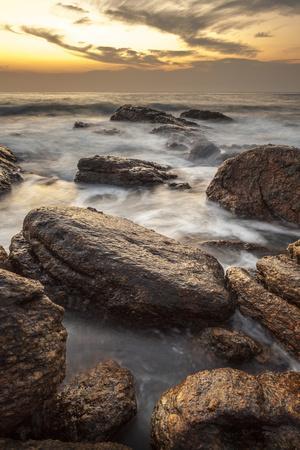 https://imgc.allpostersimages.com/img/posters/long-exposure-of-surf-and-rocks-at-sunrise-tangalle-sri-lanka-indian-ocean-asia_u-L-PQ8T7Z0.jpg?p=0