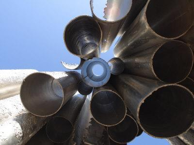 https://imgc.allpostersimages.com/img/posters/looking-up-through-hallow-metal-pipes-towards-the-sky-in-helsinki-finland_u-L-Q10X5Z50.jpg?p=0
