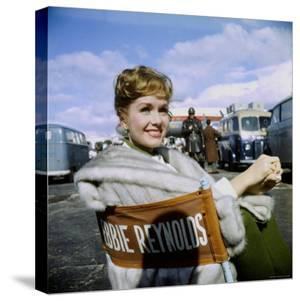 """Actress Debbie Reynolds at Airport During Filming of """"It Started with a Kiss"""" by Loomis Dean"""