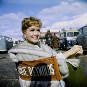 "Actress Debbie Reynolds at Airport During Filming of ""It Started with a Kiss"" by Loomis Dean"