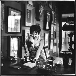 "Actress Rita Moreno Imitating the ""Sexy Wild"" Type by Loomis Dean"