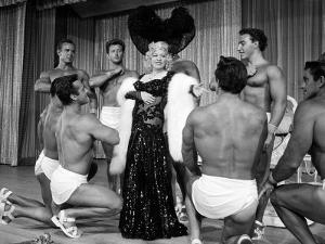 Entertainer Mae West Making Her Nightclub Debut with Loin-Clothed Dancers at Hotel Sahara by Loomis Dean