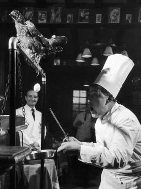 French Restaurant Owner Sam Letrone Entertaining Patrons with His Performing Chicken by Loomis Dean