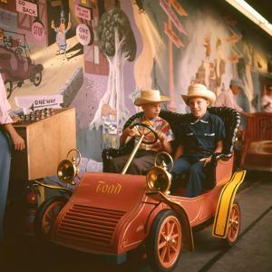 July 17 1955: Children Riding Mr Toad Vehicle in the Mr Toad Wild Ride, Disneyland, California by Loomis Dean