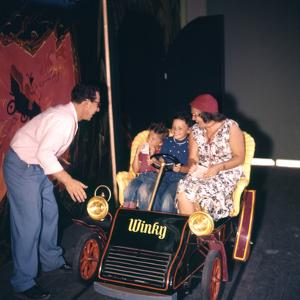 July 17 1955: Family Riding the Mr Toad Wild Ride, Disneyland, Anaheim, California by Loomis Dean