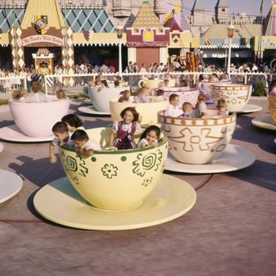 """July 17 1955: """"Mad Hatter's Tea Party"""" Ride at Disneyland Amusement Park, Anaheim, California by Loomis Dean"""