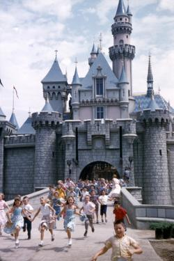July 17 1955: Sleeping Beauty's Castle Overrun by Children at Disneyland Park, California by Loomis Dean