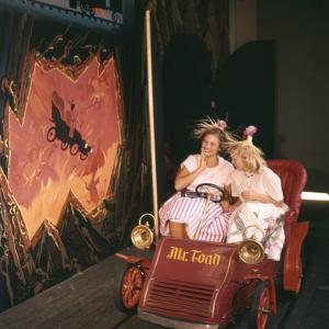 July 17 1955: Young Girls in the Mr Toad Wild Ride, Disneyland, Anaheim, California by Loomis Dean