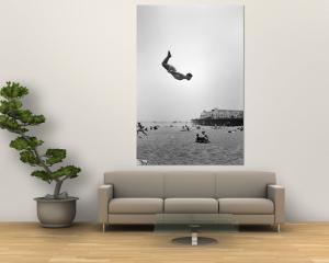 Man Flying Off a Trampoline at Santa Monica Beach by Loomis Dean