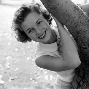 Portrait of American Actress Debbie Reynolds as She Poses Behind a Tree, 1950 by Loomis Dean