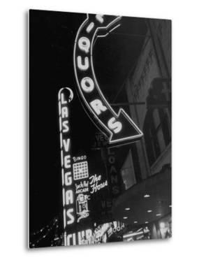 The Grand Strip of Las Vegas Lighting Up by Loomis Dean