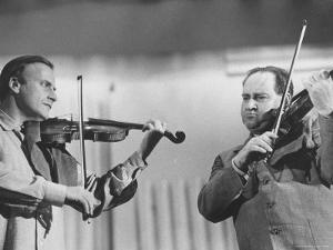 Violinists David Oistrakh and Yehudi Menuhin Rehearsing for United Nations Concert by Loomis Dean