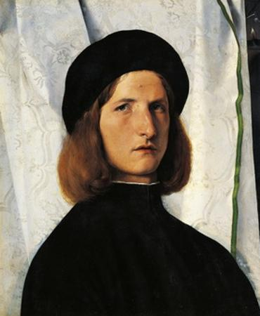 Portrait of Young Man with Lamp by Lorenzo Lotto