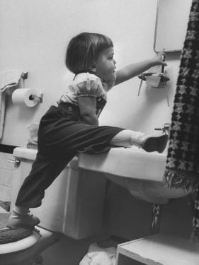 Lori Mckone in Bathroom Reaching for Toothbrush