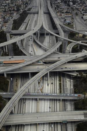 https://imgc.allpostersimages.com/img/posters/los-angeles-aerial-of-judge-harry-pregerson-interchange-and-highway_u-L-PU3EHJ0.jpg?artPerspective=n