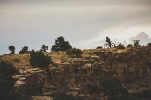 A Biker Takes In The View From The Little Grand Canyon Overlook, The Wedge, San Rafael Swell, Utah by Louis Arevalo