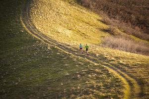 A Male and Female Run in the Foothills Above Salt Lake City, Utah by Louis Arevalo