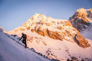 A Man Boots His Way Up West Hourglass Couloir on Nez Perce, Grand Teton, Wyoming by Louis Arevalo