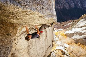 A Man Climbs Center Trinity, 5.13A, Little Cottonwood Canyon, Utah by Louis Arevalo