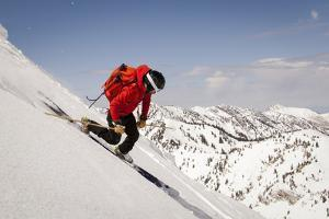 A Man Ski Drops into the Heel in the Wasatch Mountains, Utah by Louis Arevalo