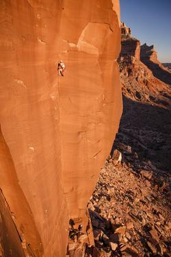 A Skilled Climber Takes a Lap, Dylan Wall, San Rafael Swell, Utah by Louis Arevalo