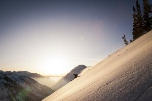 A Young Skier Races the Sun at Alta, Utah by Louis Arevalo