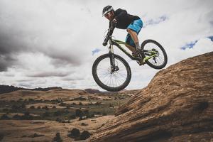 Dane Cronin Mountain Biking The Slickrock Trail In The Sand Flats Recreation Area, Moab, Utah by Louis Arevalo