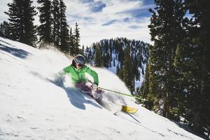 Hannah Whitney Skiing The Fresh Snow At Alta Ski Area, Utah by Louis Arevalo
