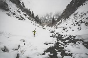 Rob Lea Hikes 200 Ft To Hwy Out Of Tanner's Chute, 3500 Ft Ski/Snowboard Couloir, Wasatch Mts, Utah by Louis Arevalo