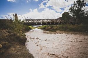 San Rafael Swell Swinging Bridge, Built By CCC, Aid Cattlemen Crossing Livestock Across River, Utah by Louis Arevalo