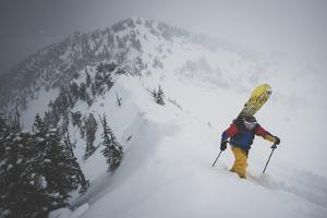 Splitboarder Maxwell Jeffrey Morrill Boots To The Summit Of Toledo Bowl, Wasatch Mountains, Utah by Louis Arevalo