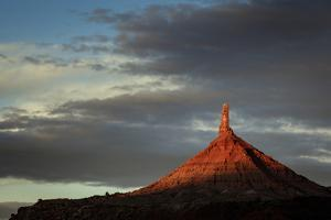 Sunrise on North Sixshooter Tower, Indian Creek, Utah by Louis Arevalo