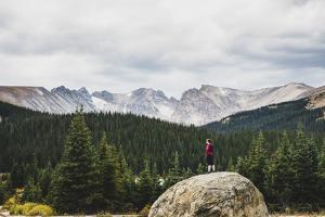 Woman Stands On A Boulder In The Brainard Lake Recreation Area, Indian Peaks Wilderness, Colorado by Louis Arevalo