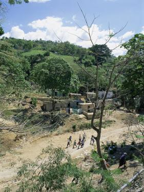 Houses and People Walking in Dry River Bed Caused by Erosion, Near Petionville, Haiti, West Indies by Lousie Murray