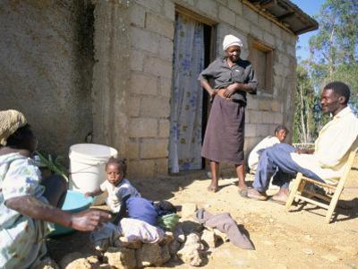 Woman Washing Clothes Outside Shack, Godet, Haiti, Island of Hispaniola by Lousie Murray