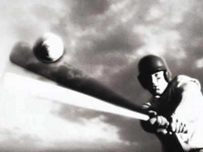 Low Angle View of a Baseball Player Swinging a Baseball Bat