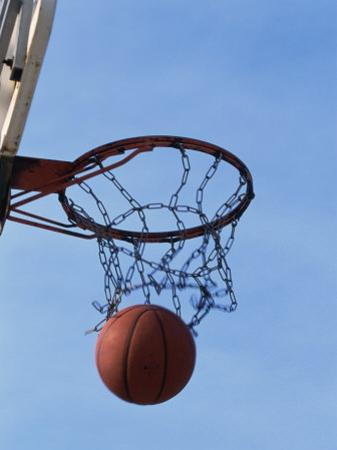 Low Angle View of a Basketball Going Through The Hoop
