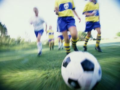 Low Angle View of a Girls Soccer Team Playing Soccer on a Field
