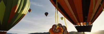 Low angle view of hot air balloons in a balloon festival, Taos Balloon Fiesta, Taos, Taos County...
