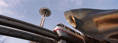 https://imgc.allpostersimages.com/img/posters/low-angle-view-of-the-monorail-and-space-needle-seattle-washington-state-usa_u-L-OK8HZ0.jpg?p=0