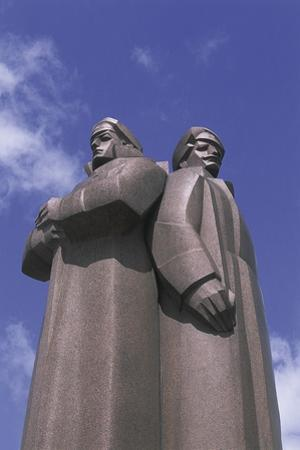 Low Angle View of Two Statues, Red Latvian Riflemen, Riga, Latvia