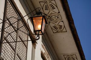 Low angle view of vintage lantern on wall, Vigan, Ilocos Sur, Philippines