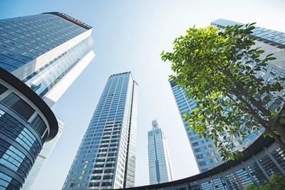 https://imgc.allpostersimages.com/img/posters/low-wide-angle-view-of-a-group-of-new-skyscrapers-combined-with-fresh-greenery-in-jianggan_u-L-PWFF0J0.jpg?p=0