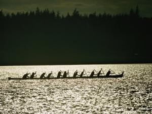 Lummi Indians Paddle a Large Canoe by Lowell Georgia