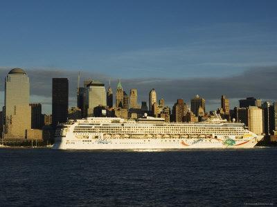 https://imgc.allpostersimages.com/img/posters/lower-manhattan-skyline-and-cruise-ship-across-the-hudson-river-new-york-city-new-york-usa_u-L-P1KALB0.jpg?p=0