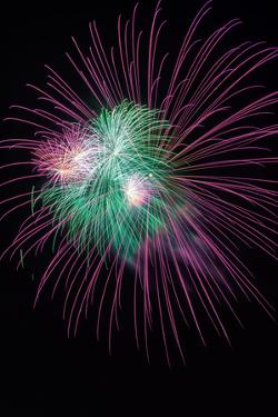 Green and Violet Amazing Fireworks Isolated in Dark Background by lucky-photographer