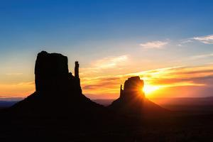 Shilouette of Monument Valley at Sunrise, Arizona by lucky-photographer