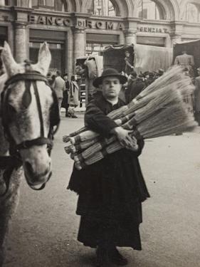 A Priest Carries the Broom Sorghum by Luigi Leoni